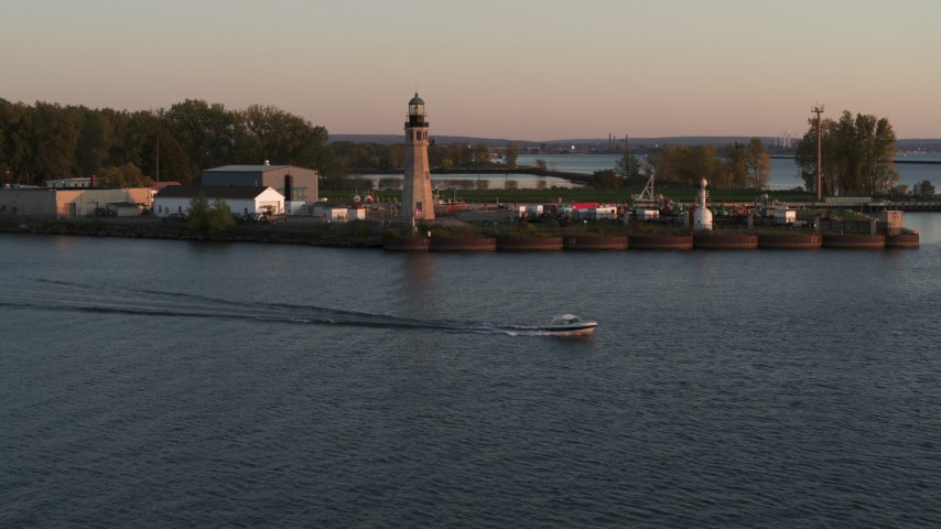 5.7K stock footage aerial video approach Lake Erie lighthouse at sunset, Buffalo, New York Aerial Stock Footage | DX0002_204_017