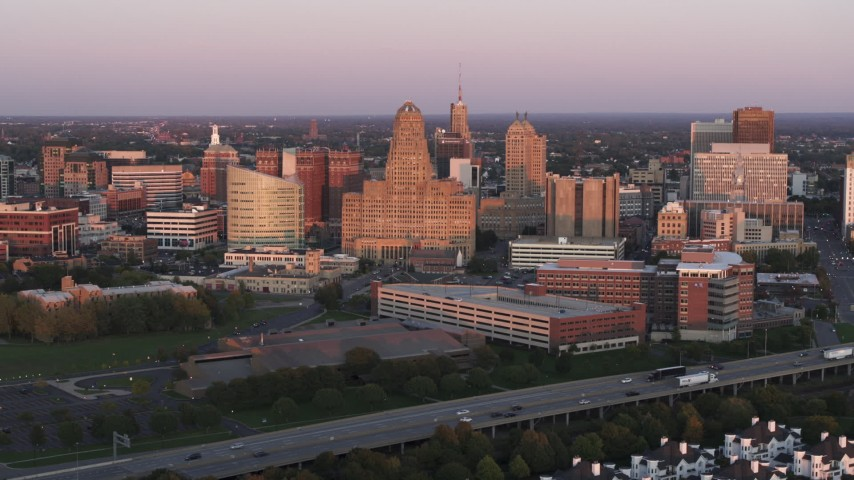 5.7K stock footage aerial video of city hall and a courthouse by office buildings at sunset, Downtown Buffalo, New York Aerial Stock Footage | DX0002_204_022