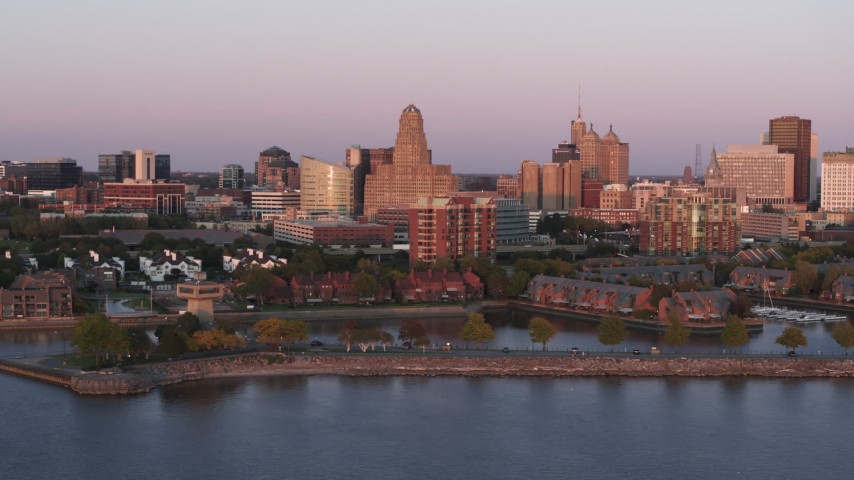 5.7K stock footage aerial video of city hall and office buildings at sunset, seen from waterfront condos, Downtown Buffalo, New York Aerial Stock Footage | DX0002_204_024