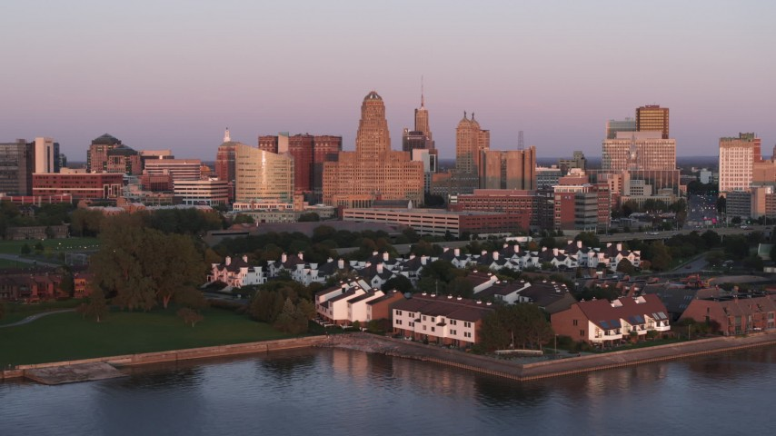 5.7K stock footage aerial video a view of city hall and office buildings at sunset, seen from waterfront condos, Downtown Buffalo, New York Aerial Stock Footage | DX0002_204_025