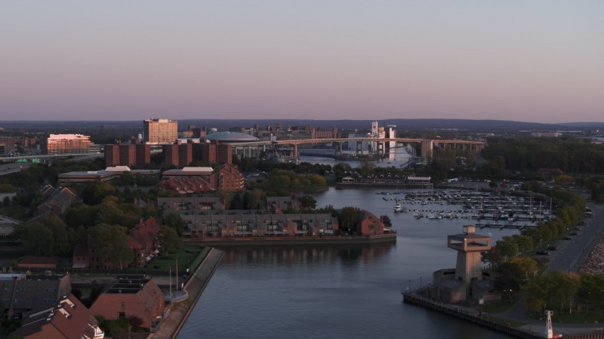 5.7K stock footage aerial video of the Buffalo Skyway behind marina at sunset, Downtown Buffalo, New York Aerial Stock Footage | DX0002_204_026