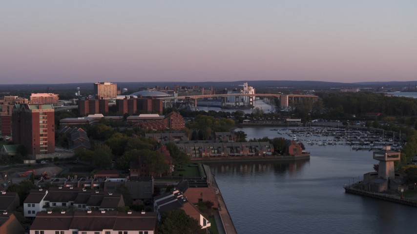 5.7K stock footage aerial video of a wide view of the Buffalo Skyway behind marina at sunset, Downtown Buffalo, New York Aerial Stock Footage | DX0002_204_027