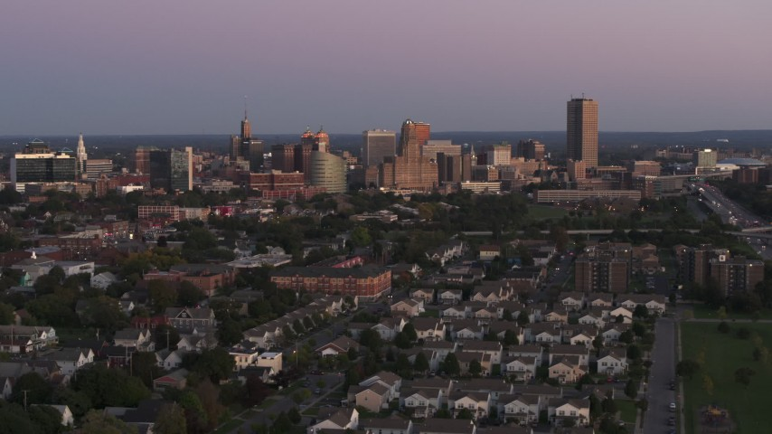 5.7K stock footage aerial video of a wide view of the city's skyline at twilight, Downtown Buffalo, New York Aerial Stock Footage | DX0002_204_028