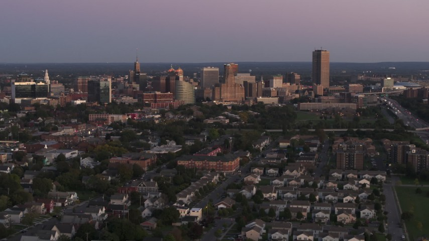 5.7K stock footage aerial video of flying by the city's skyline at twilight, Downtown Buffalo, New York Aerial Stock Footage | DX0002_204_029