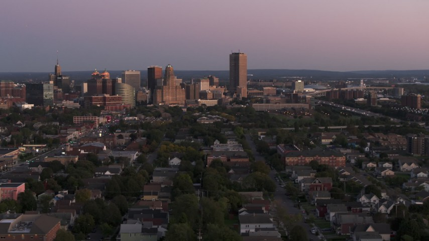 5.7K stock footage aerial video wide view of Seneca One Tower and the city's skyline at twilight, Downtown Buffalo, New York Aerial Stock Footage | DX0002_204_031