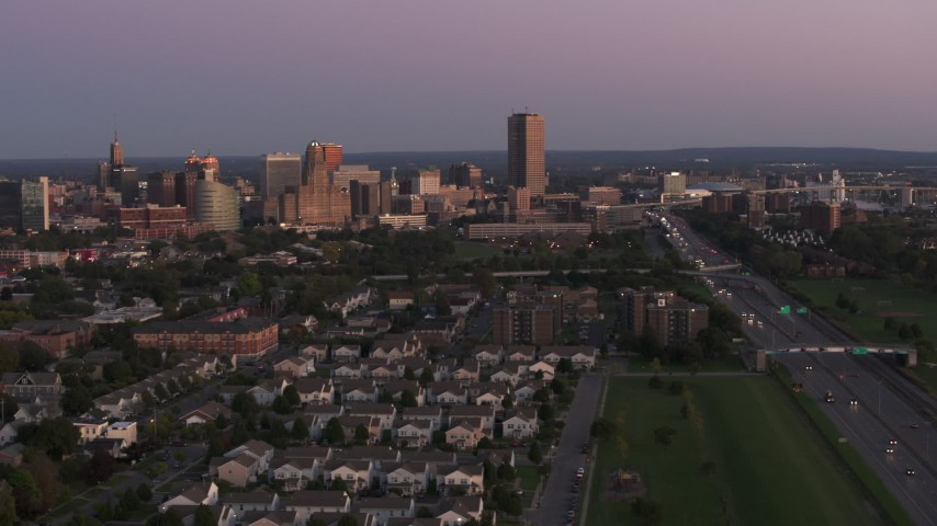 5.7K stock footage aerial video wide view of Seneca One Tower and the city's skyline seen from I-190 at twilight, Downtown Buffalo, New York Aerial Stock Footage | DX0002_204_032