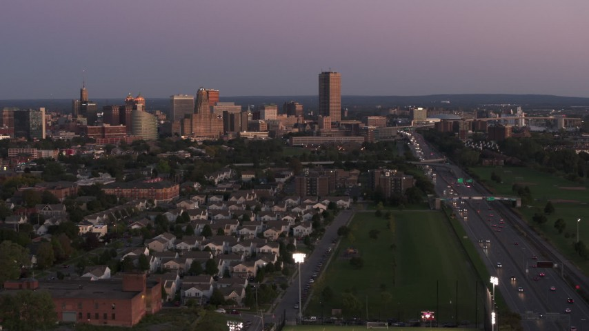 5.7K stock footage aerial video wide view of Seneca One Tower and the city's skyline seen from neighborhood at twilight, Downtown Buffalo, New York Aerial Stock Footage | DX0002_204_033