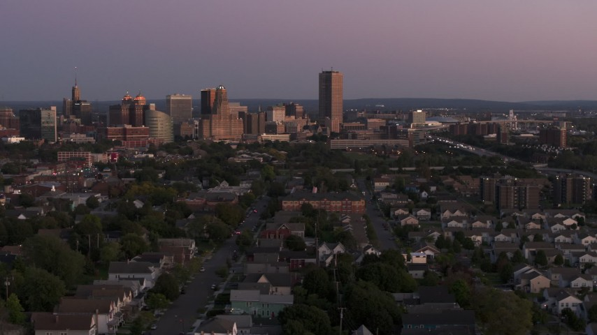 5.7K stock footage aerial video wide view of Seneca One Tower and the city's skyline seen from homes at twilight, Downtown Buffalo, New York Aerial Stock Footage | DX0002_204_034