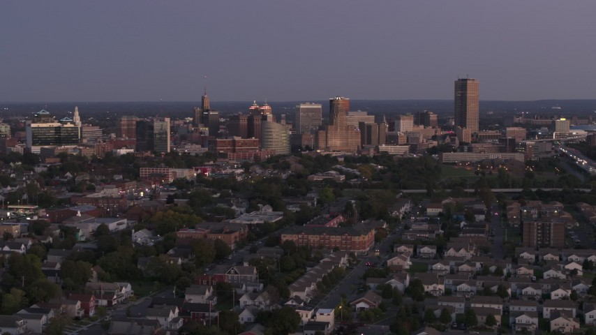 5.7K stock footage aerial video of flying by the skyline seen from apartments and homes at twilight, Downtown Buffalo, New York Aerial Stock Footage | DX0002_204_041