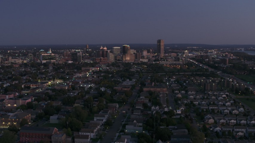 5.7K stock footage aerial video of the skyline seen from apartments and homes at twilight, Downtown Buffalo, New York Aerial Stock Footage | DX0002_204_043