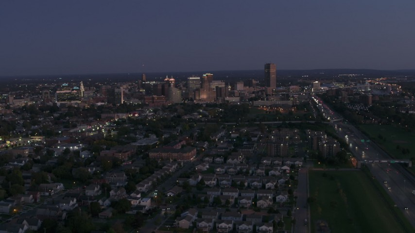 5.7K stock footage aerial video of the skyline while ascending over neighborhoods at twilight, Downtown Buffalo, New York Aerial Stock Footage | DX0002_204_045