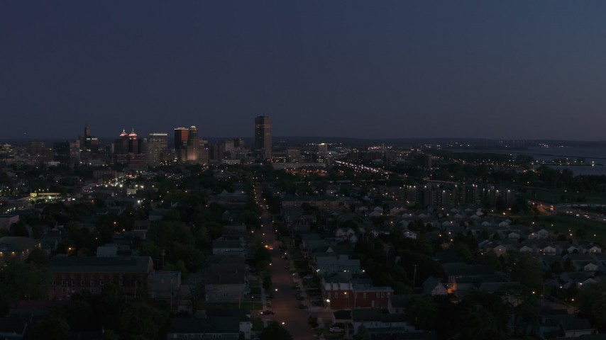 5.7K stock footage aerial video of a tall skyscraper and skyline at twilight, Downtown Buffalo, New York Aerial Stock Footage | DX0002_204_049