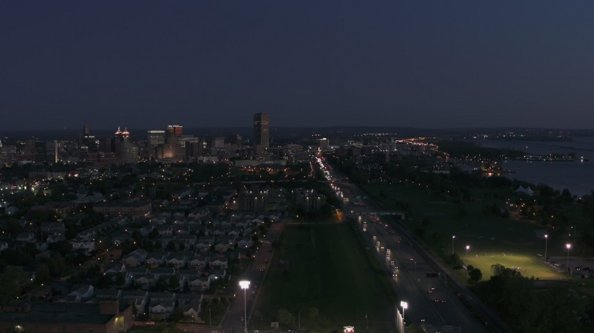 5.7K stock footage aerial video reverse view of I-190 leading to skyline at twilight, Downtown Buffalo, New York Aerial Stock Footage | DX0002_204_051