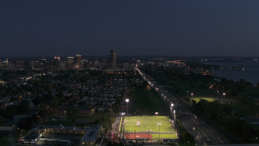 5.7K stock footage aerial video fly away from I-190 leading to skyline at twilight, Downtown Buffalo, New York Aerial Stock Footage | DX0002_204_052