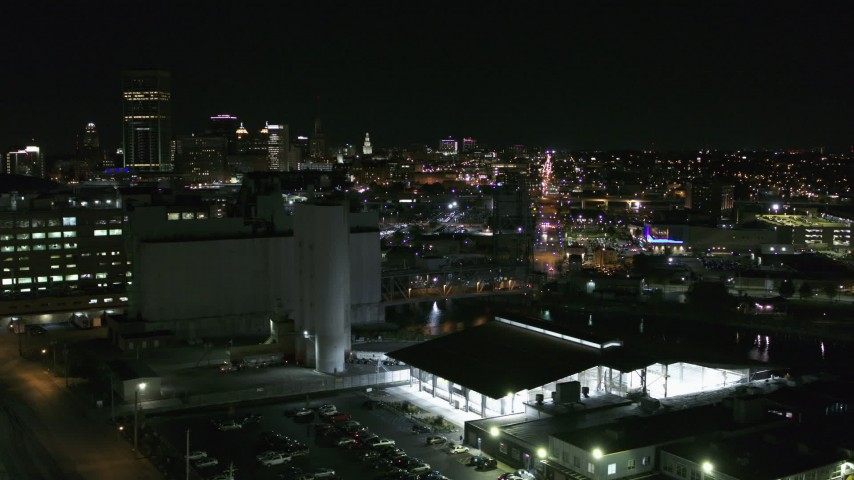 5.7K stock footage aerial video of flying by grain elevators with a view of the skyline at night, Downtown Buffalo, New York Aerial Stock Footage | DX0002_205_007