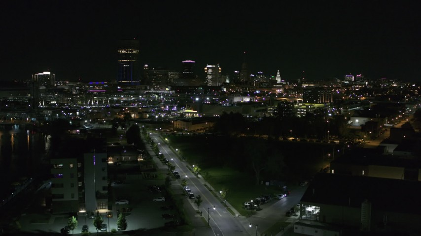 5.7K stock footage aerial video of a reverse view of the skyline at night, Downtown Buffalo, New York Aerial Stock Footage | DX0002_205_008