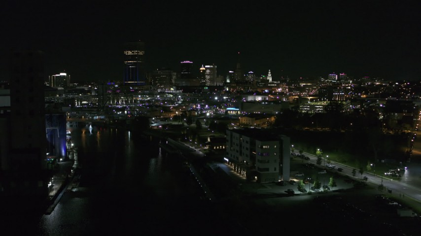 5.7K stock footage aerial video of following Buffalo River toward the skyline at night, Downtown Buffalo, New York Aerial Stock Footage | DX0002_205_009