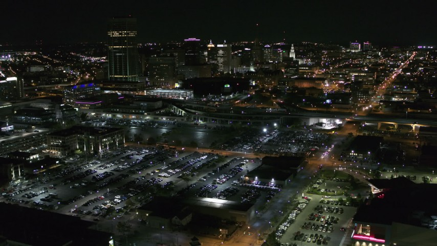 5.7K stock footage aerial video of flying toward and past the skyline at night, Downtown Buffalo, New York Aerial Stock Footage | DX0002_205_010