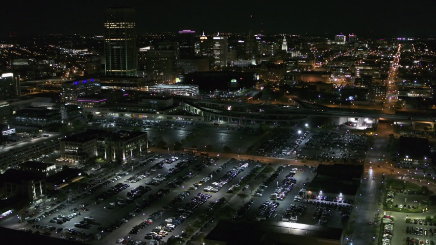 5.7K stock footage aerial video of flying away from parking lots and skyline at night, Downtown Buffalo, New York Aerial Stock Footage | DX0002_205_011
