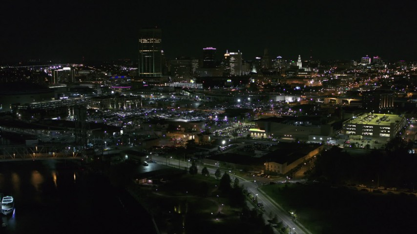 5.7K stock footage aerial video of the skyline while descending by river at night, Downtown Buffalo, New York Aerial Stock Footage | DX0002_205_012