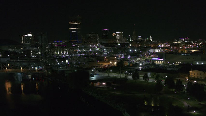 5.7K stock footage aerial video approach the skyline from river and parking lots at night, Downtown Buffalo, New York Aerial Stock Footage | DX0002_205_013