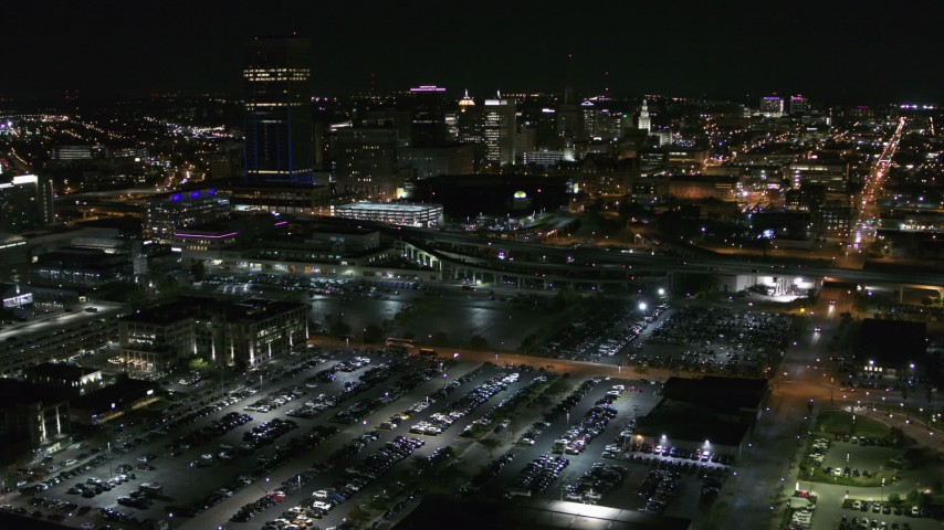 5.7K stock footage aerial video reverse view of the skyline from arena parking lots at night, Downtown Buffalo, New York Aerial Stock Footage | DX0002_205_014