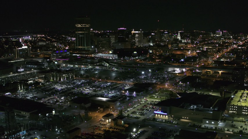 5.7K stock footage aerial video reverse view of the skyline near arena parking lots at night, Downtown Buffalo, New York Aerial Stock Footage | DX0002_205_015