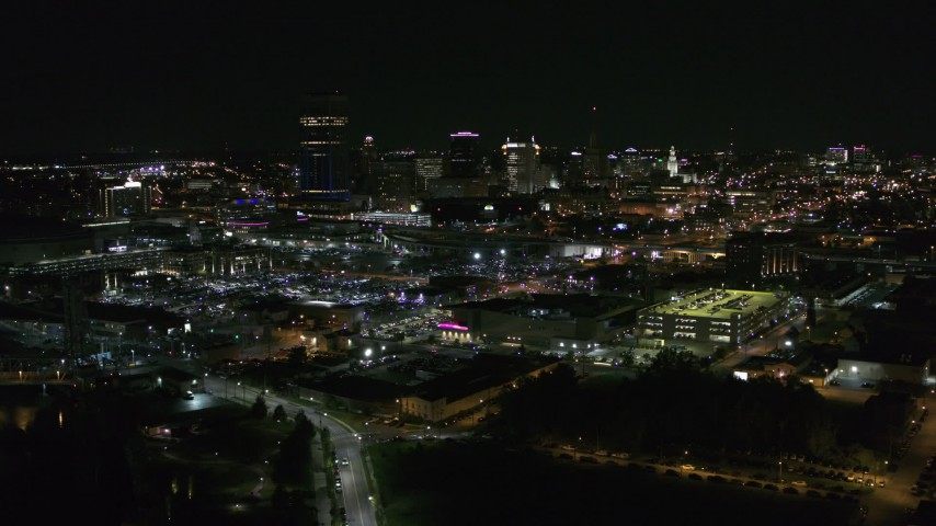 5.7K stock footage aerial video of flying past the downtown skyline at night, Downtown Buffalo, New York Aerial Stock Footage | DX0002_205_016