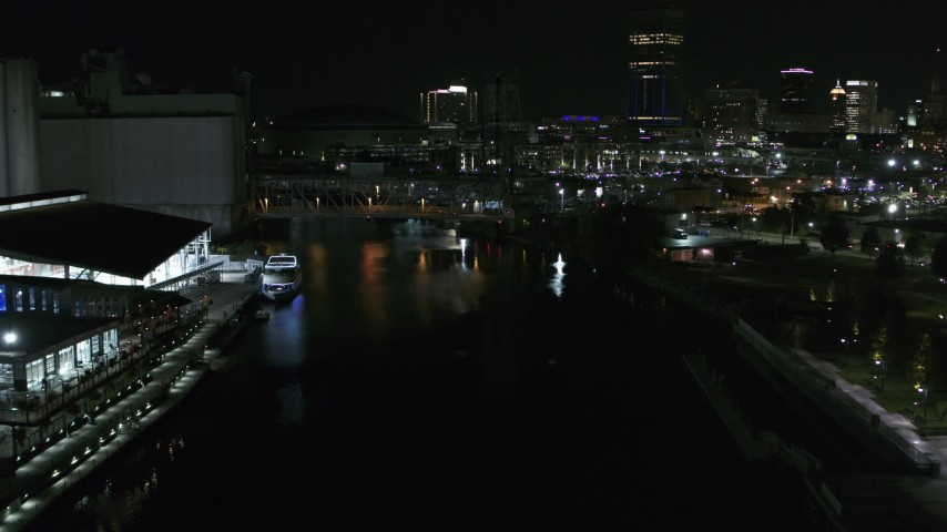 5.7K stock footage aerial video of flying over the river toward the downtown skyline at night, Downtown Buffalo, New York Aerial Stock Footage | DX0002_205_025