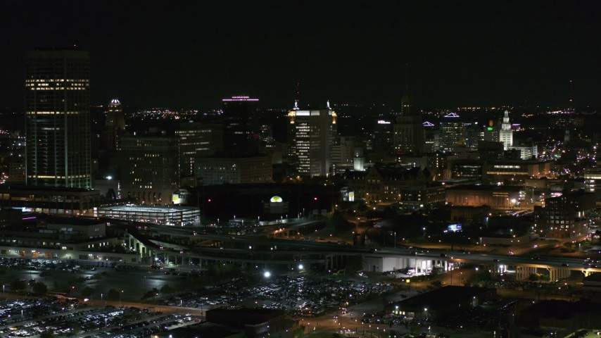 5.7K stock footage aerial video of passing by a skyscraper and office towers at night, Downtown Buffalo, New York Aerial Stock Footage | DX0002_205_028