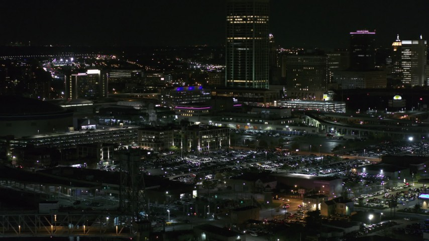 5.7K stock footage aerial video of flying by parking lots near the skyscraper at night, Downtown Buffalo, New York Aerial Stock Footage | DX0002_205_032