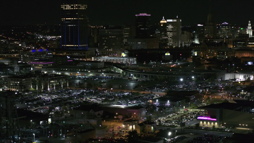 5.7K stock footage aerial video of passing by the skyline seen from parking lots at night, Downtown Buffalo, New York Aerial Stock Footage | DX0002_205_035