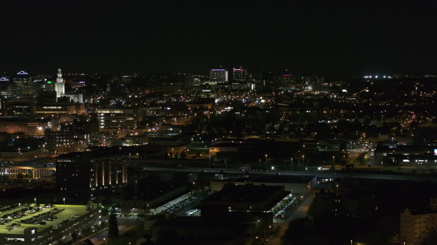 5.7K stock footage aerial video of a wide view of Buffalo General Medical Center at night, Downtown Buffalo, New York Aerial Stock Footage | DX0002_205_036