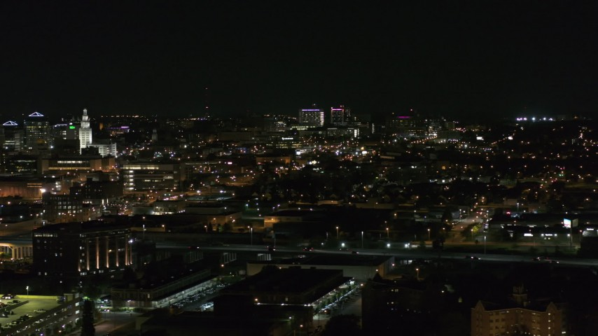 5.7K stock footage aerial video of a wide view of distant Buffalo General Medical Center at night, Downtown Buffalo, New York Aerial Stock Footage | DX0002_205_037
