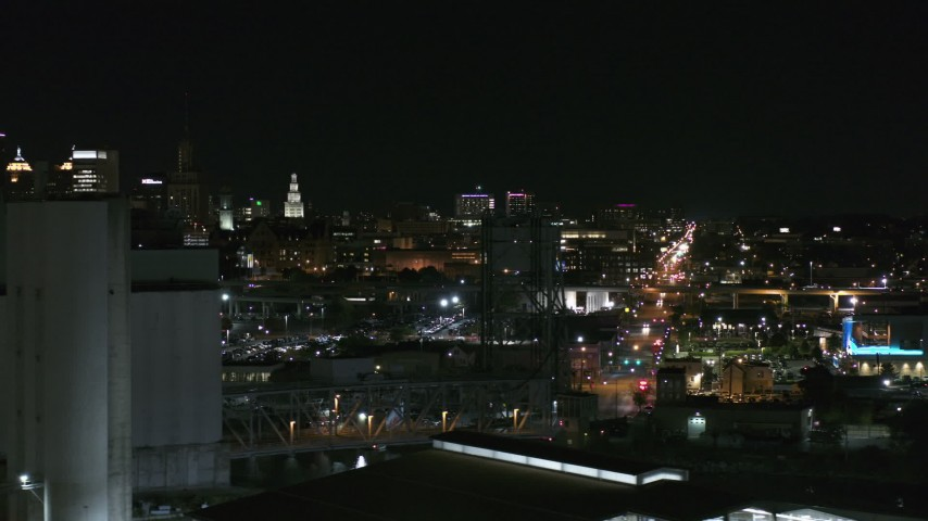 5.7K stock footage aerial video of distant Buffalo General Medical Center seen from grain elevators at night, Downtown Buffalo, New York Aerial Stock Footage | DX0002_205_039