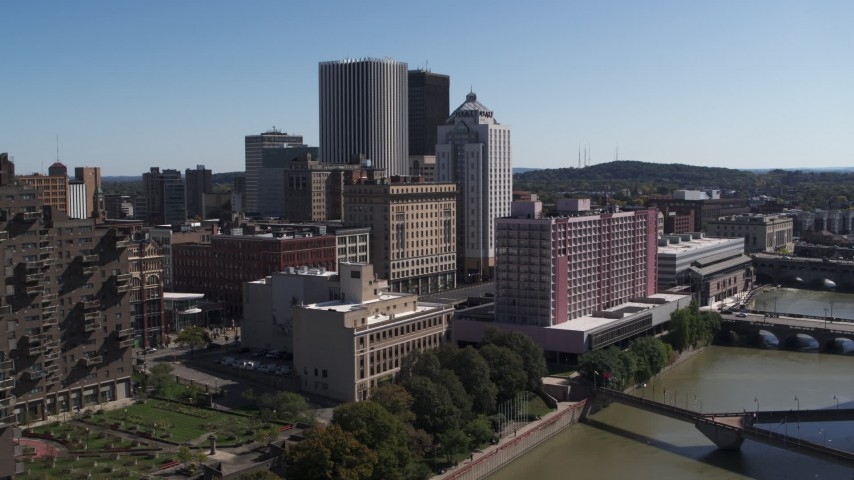 5.7K stock footage aerial video approach riverfront hotels and the city's skyline, Downtown Rochester, New York Aerial Stock Footage | DX0002_206_001