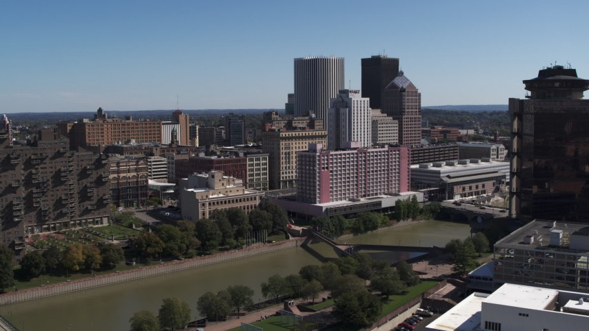 5.7K stock footage aerial video of riverfront hotels and the city's skyline across the river, Downtown Rochester, New York Aerial Stock Footage | DX0002_206_005