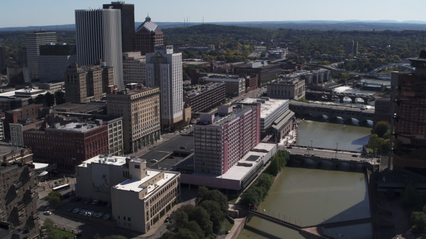 5.7K stock footage aerial video reverse view of riverfront hotel and city's skyline, Downtown Rochester, New York Aerial Stock Footage | DX0002_206_007