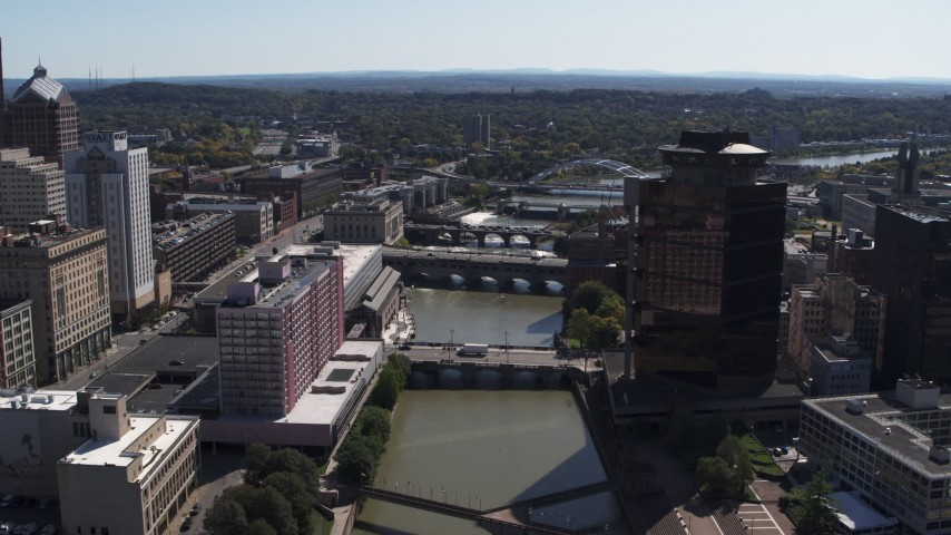 5.7K stock footage aerial video reverse view of riverfront hotel across from office building, Downtown Rochester, New York Aerial Stock Footage | DX0002_206_008