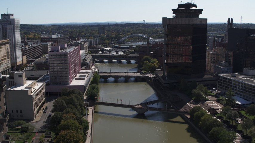 5.7K stock footage aerial video ascend toward riverfront hotel across from office building, Downtown Rochester, New York Aerial Stock Footage | DX0002_206_009