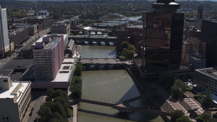 5.7K stock footage aerial video fly away from riverfront hotel across from office building, Downtown Rochester, New York Aerial Stock Footage | DX0002_206_010