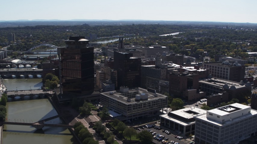 5.7K stock footage aerial video stationary view of office buildings by the Genessee River, Downtown Rochester, New York Aerial Stock Footage | DX0002_206_012