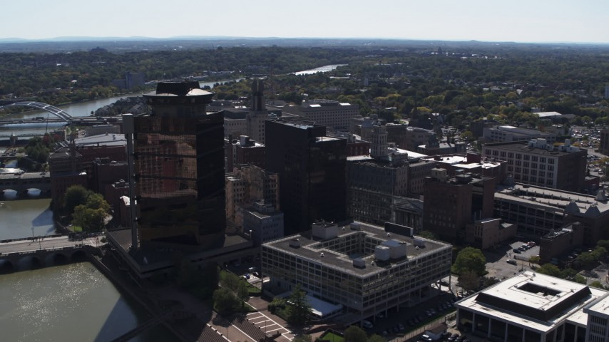 5.7K stock footage aerial video of office buildings and hotel by the Genessee River, Downtown Rochester, New York Aerial Stock Footage | DX0002_206_013