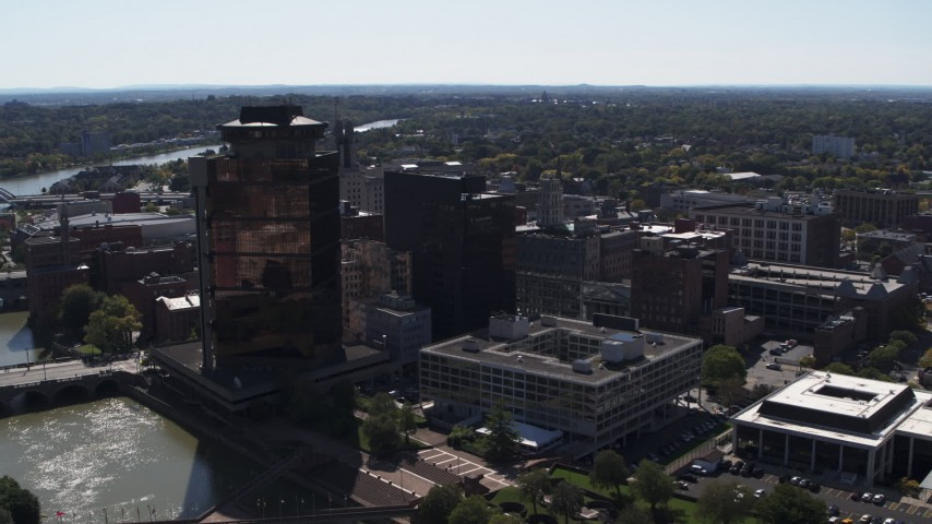5.7K stock footage aerial video descend with view of office buildings and hotel by the Genessee River, Downtown Rochester, New York Aerial Stock Footage | DX0002_206_014