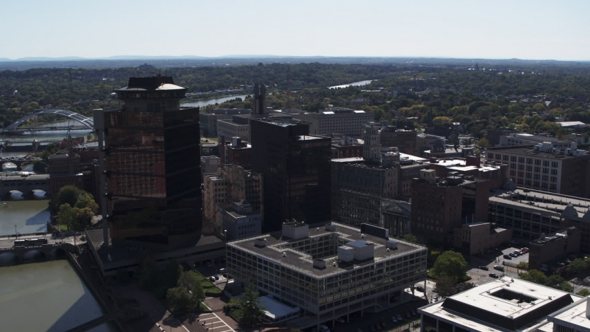 5.7K stock footage aerial video orbit office buildings and hotel by the Genessee River, Downtown Rochester, New York Aerial Stock Footage | DX0002_206_015