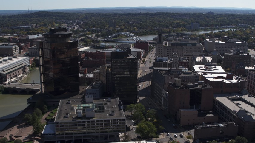 5.7K stock footage aerial video or circling office buildings and hotel by the Genessee River, Downtown Rochester, New York Aerial Stock Footage | DX0002_206_016
