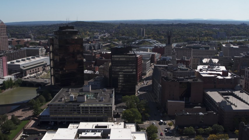 5.7K stock footage aerial video focus on riverfront office towers during descent, Downtown Rochester, New York Aerial Stock Footage | DX0002_206_017
