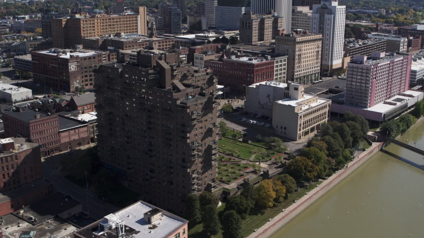5.7K stock footage aerial video orbit and approach riverfront apartment complex in Downtown Rochester, New York Aerial Stock Footage | DX0002_206_023
