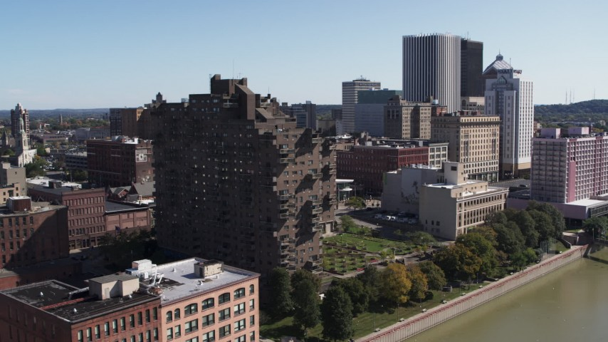 5.7K stock footage aerial video orbit riverfront apartment complex overlooking the river, Downtown Rochester, New York Aerial Stock Footage | DX0002_206_025