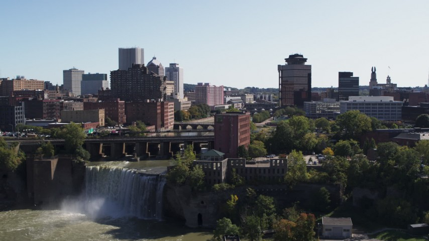 5.7K stock footage aerial video reverse view of the city's skyline and river, reveal the falls, Downtown Rochester, New York Aerial Stock Footage | DX0002_206_033